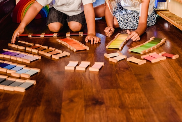 Children playing and learning with montessori color tablets