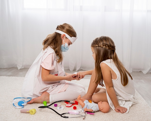 Children playing a medical game at home