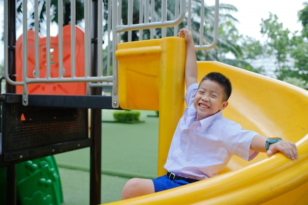 Children playing at the playground, happy boy