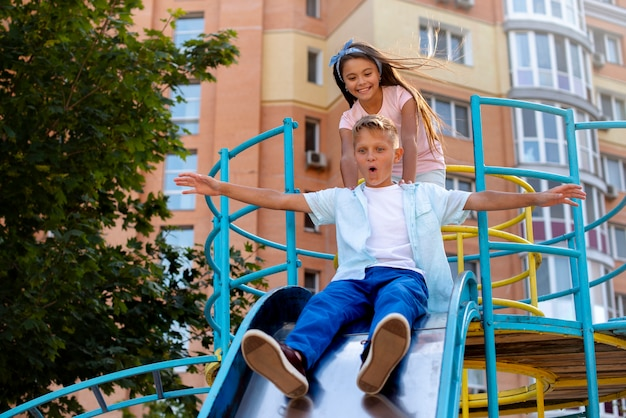 Children playing on a slide on the playground