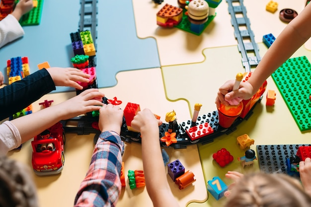 Children playing with constructor blocks at class
