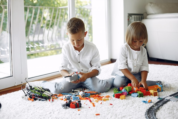 Children playing with lego in a playing room