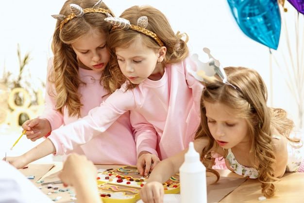Children playing with mosaic puzzle