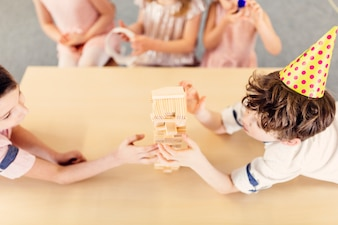Children playing wooden game