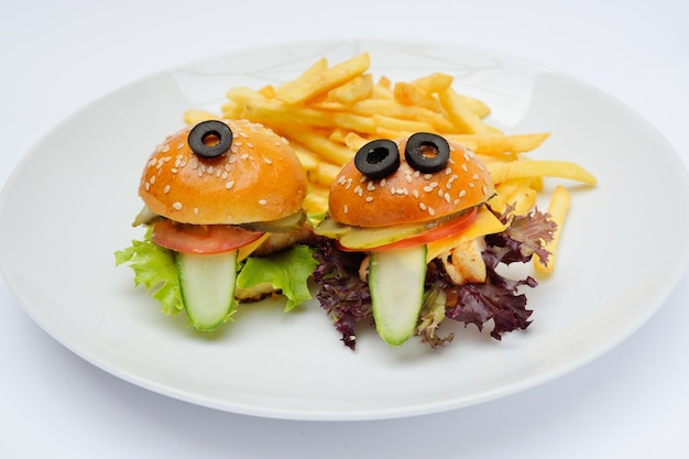 Children's burgers on a plate close-up