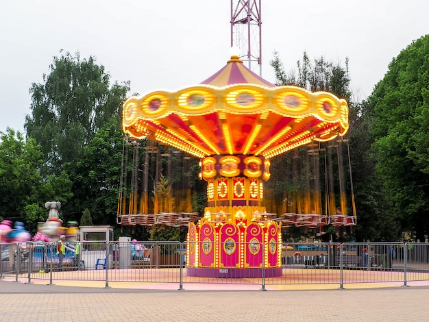 Children's carousel in the evening lights