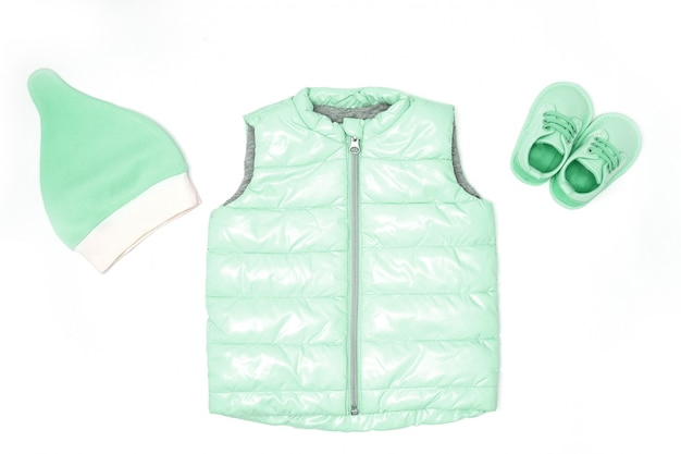 Children's clothes in fashionable color. hat, shoes, quilted jacket