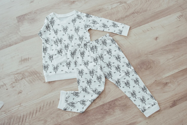 Children's clothing set isolated on wooden background