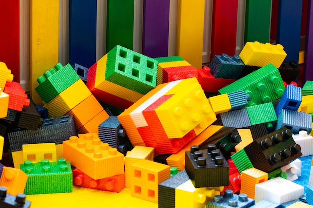 Children's cubes,designer chaotically scattered, background, figures.