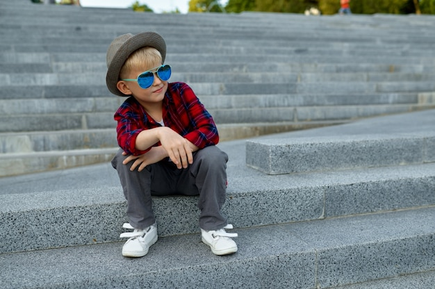 Children's date, macho boy waiting for a girl