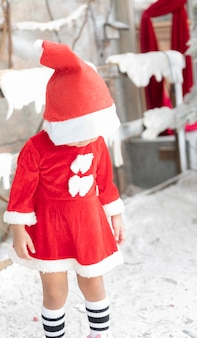 Children's day red dress in christmas holidays and concepts in childhood smiling girl in red dress