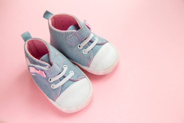 Children's denim sports shoes for girls, stands on a pink