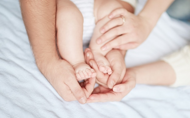 Children's feet in the hands of parents .conceptual image of fatherhood.