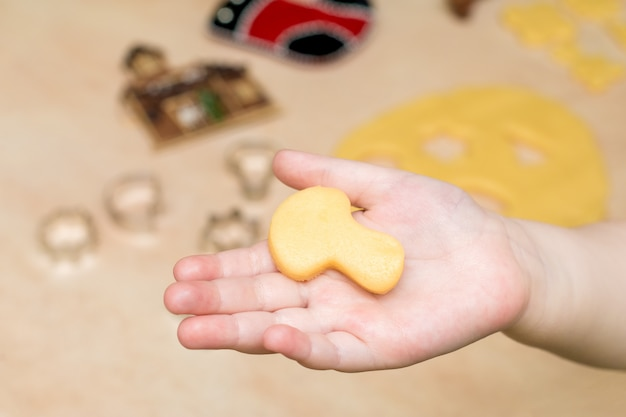 Children's hands make christmas cookies
