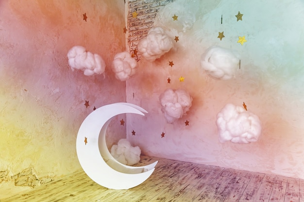 Children's location for a photo shoot. moon with stars and clouds dreamy decor. elements of the interior.interior moon and stars