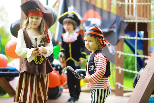 Children's party in a pirate style. children in pirate costumes are playing on halloween.
