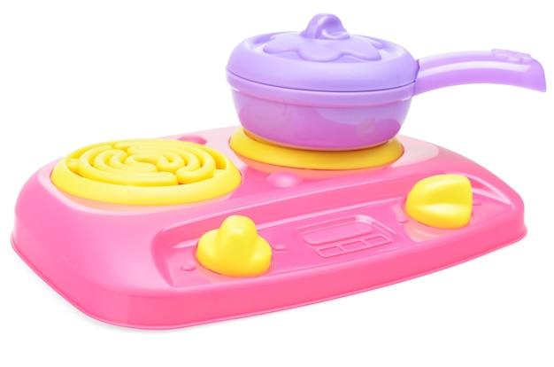 어린이 분홍색 플라스틱 요리 스토브와 보라색 냄비 또는 프라이팬 흰색 배경에