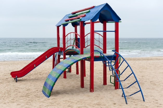 A children's play area for active games on a beach. colorful empty playground in a park near the sea. improvement of public spaces.
