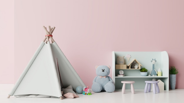In children's playroom with tent and table sitting doll on empty pink wall.