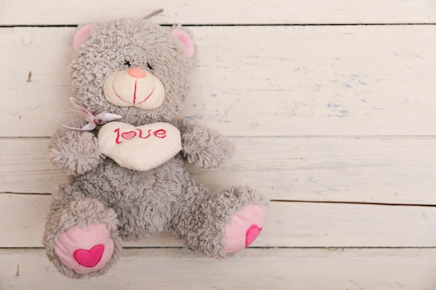 Children's plush on a white wooden. animal toy for small kids for playing.