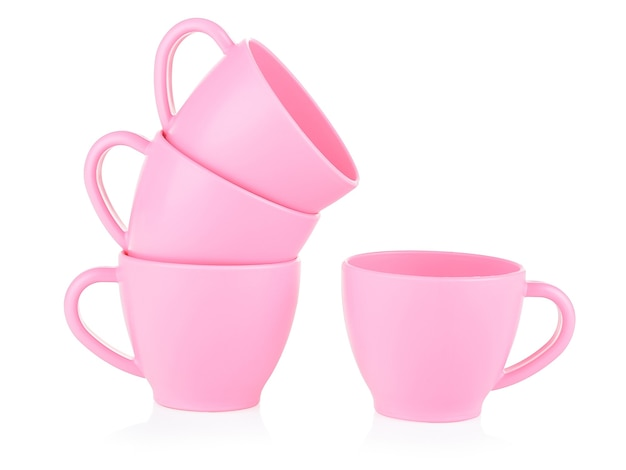 Children's small pink mugs stand on top of each other on a white background.