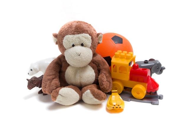 Детские игрушки на белой поверхности