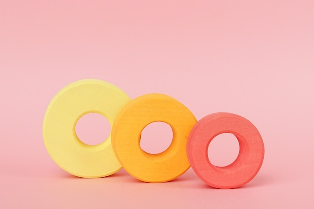 Children's wooden rings of orange and yellow