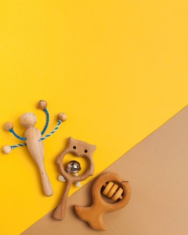 Children's wooden toys, rattles and teethers. copy space.