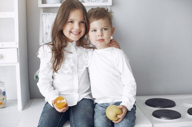 Children sitting in a kitchen at home