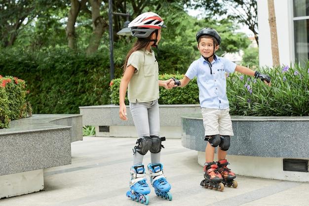 Children skating together outdoors