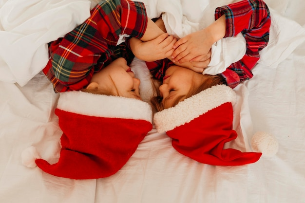 Children sleeping together on christmas day