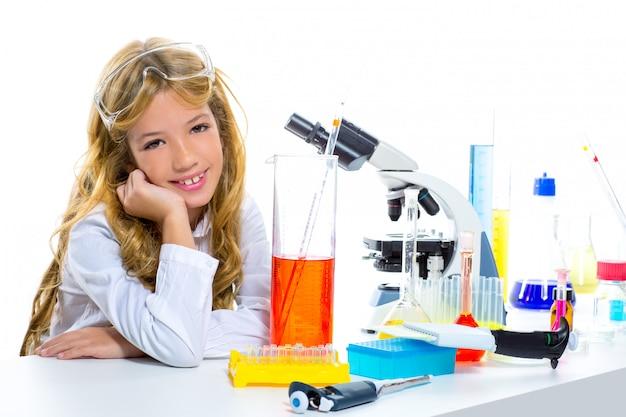 Children student girl in kid chemical laboratory