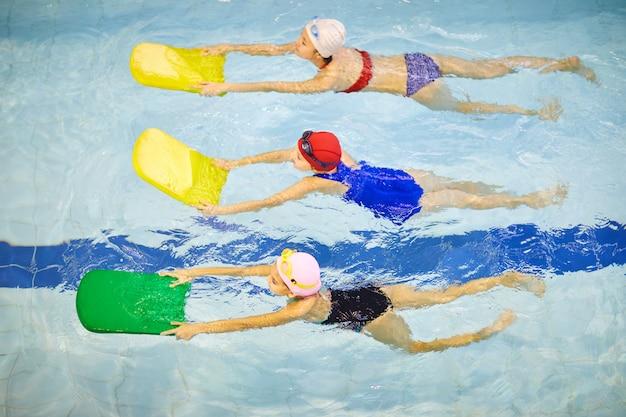 Children swimming in pool