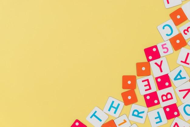 Children toys frame on yellow