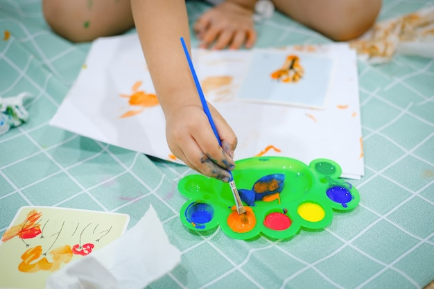 Children use watercolor brushes to create imagination and enhance their learning skills.