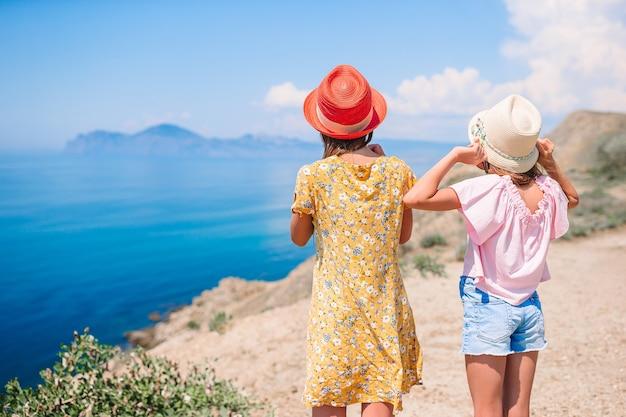 Children on vacation on white rock background