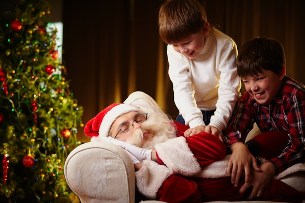 Children waking up to santa claus