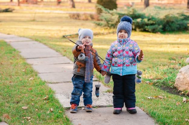 Children walk through the park