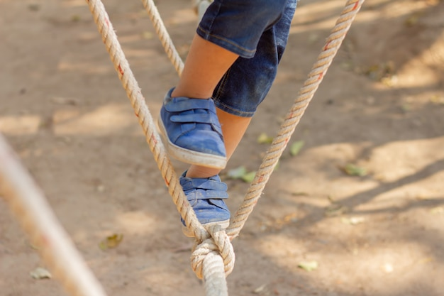 Children walking under the rope