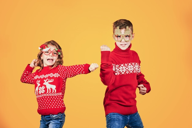 Children in warm red christmas sweaters