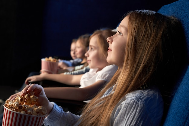 Children watching movie in cinema theatre.