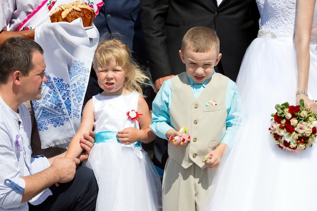 Children at a wedding with candies in their hands