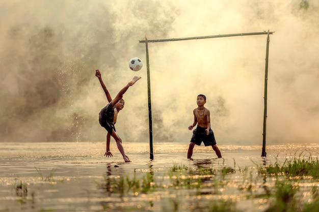 Children who were in thailand living in the countryside a football practice