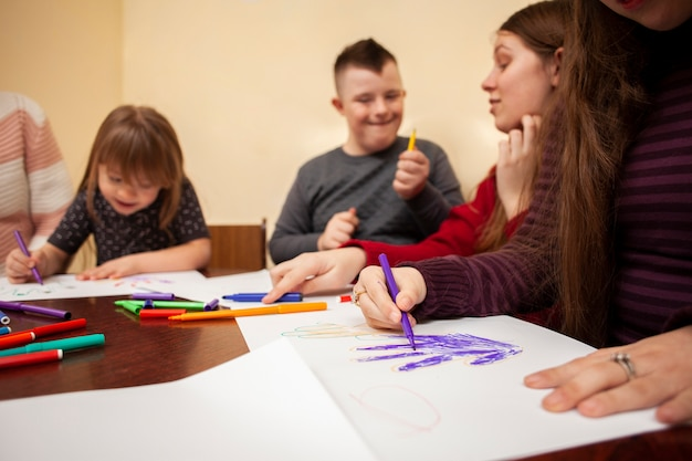 Children with down syndrome drawing and having fun