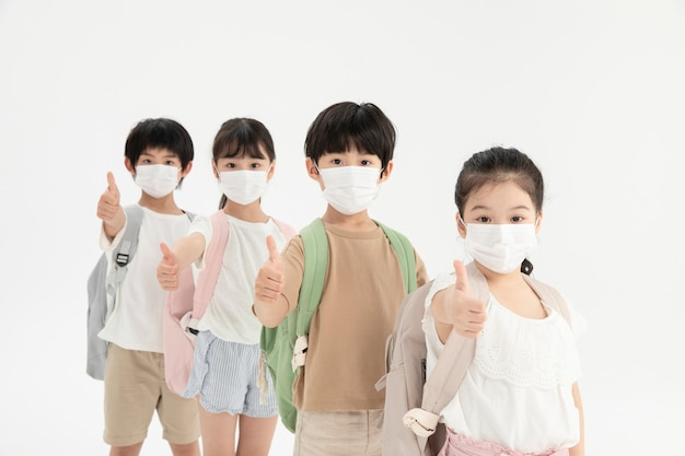 Children with protective face masks