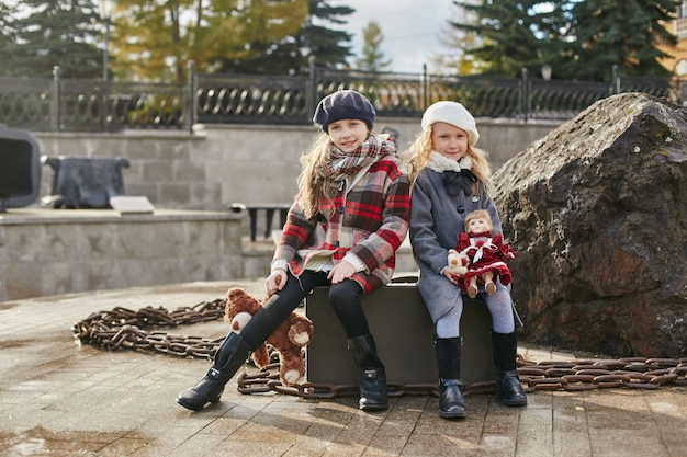 Children with suitcases travel, retro autumn spring clothes