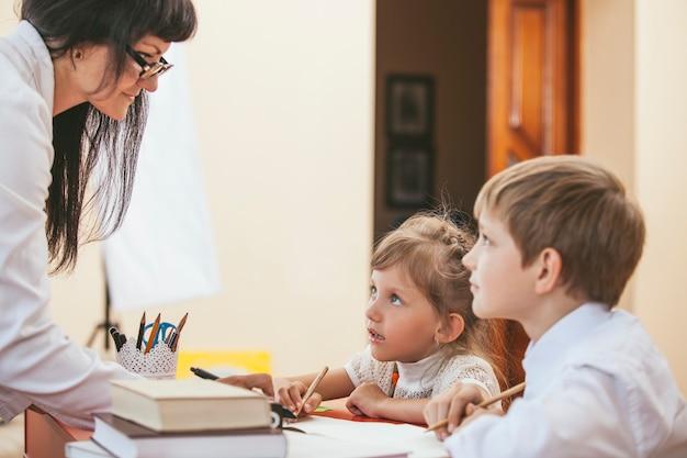 Children with the teacher in the schoo