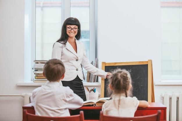 Children with the teacher in the school