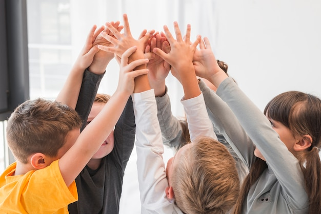 Children with their hands up