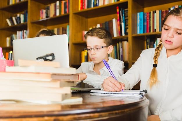 Children working hard on home assignment